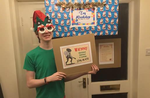 Elf under Toy Workshop sign