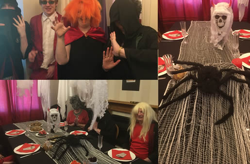 A horror murder mystery dinner party - Entrance, guests at table and spider and skull