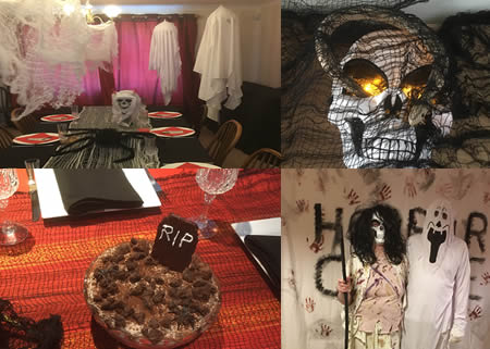 Horror party decor - a table with ghosts hanging from the ceiling, a skull and creepy cloth and a giant spider; skull mask with fake candles, a snake and creepy cloth; Horror Castle sign with bloody handprints, RIP tiramasu trifle