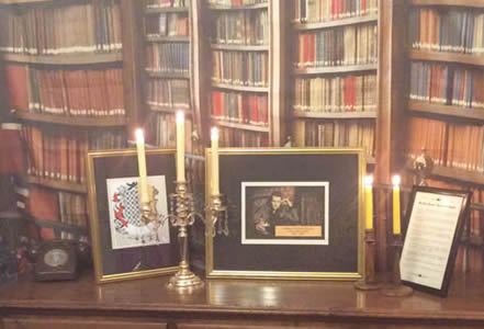 Manor house murder mystery - shrine to the victim with a library backdrop