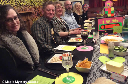 Nineties murder mystery party for 14 guests; seated at table with starters being served