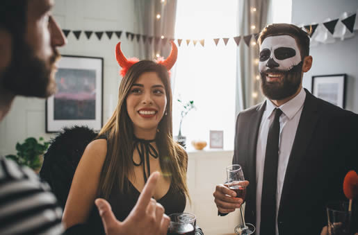 Vampire and zombie at party